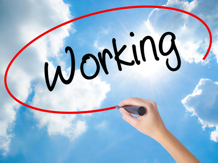 Woman Hand Writing Working with black marker on visual screen. Isolated on Sunny Sky. Business concept. Stock Photo