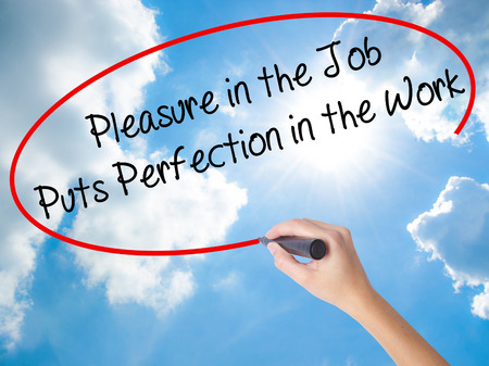 perfectionist: Woman Hand Writing Pleasure in the Job Puts Perfection in the Work with black marker on visual screen. Isolated on Sunny Sky. Business concept. Stock Photo