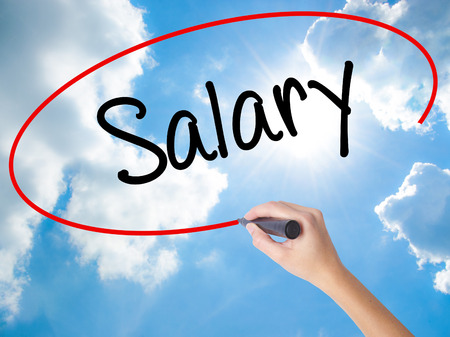 remuneración: Woman Hand Writing Salary  with black marker on visual screen. Isolated on Sunny Sky. Business concept. Stock Photo