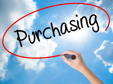 Woman Hand Writing Purchasing with black marker on visual screen. Isolated on Sunny Sky. Business concept. Stock Photo Stock Photo