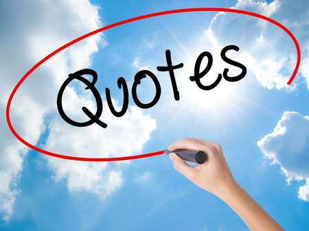 Woman Hand Writing Quotes  with black marker on visual screen. Isolated on Sunny Sky. Business concept. Stock Photo