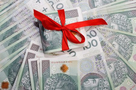 Polish Money and red ribbon. Banknotes from Poland as a gift. Business, technology, internet concept. Stock Photo
