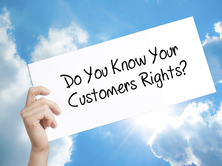 Man Hand Holding Paper with text Do You Know Your Customers Rights? . Sign on white paper. Isolated on Sky background.  Business concept. Stock Photo