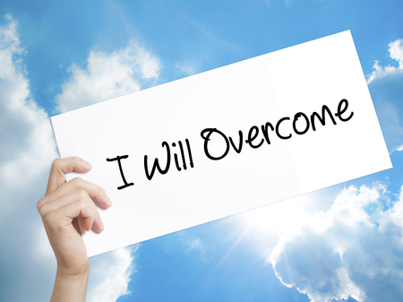 failed politics: Man Hand Holding Paper with text I Will Overcome . Sign on white paper. Isolated on Sky background.   Business concept. Stock Photo