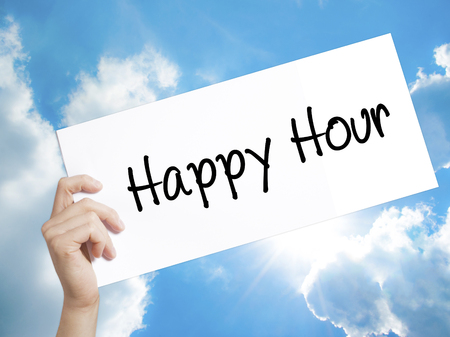 happyhour: Man Hand Holding Paper with text Happy Hour . Sign on white paper. Isolated on Sky background.  Business concept. Stock Photo