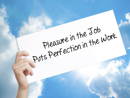 perfectionist: Man Hand Holding Paper with text Pleasure in the Job Puts Perfection in the Work . Sign on white paper. Isolated on Sky background.  Business concept. Stock Photo Stock Photo