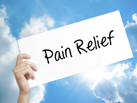 road to recovery: Man Hand Holding Paper with text Pain Relief . Sign on white paper. Isolated on Sky background.   Business concept. Stock Photo