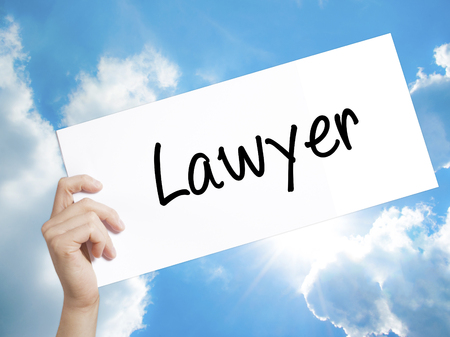 lawer: Man Hand Holding Paper with text Lawyer . Sign on white paper. Isolated on Sky background.  Business concept. Stock Photo