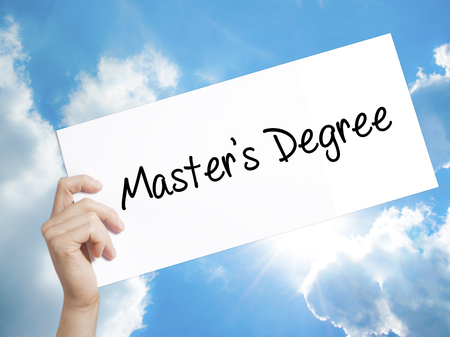 master degree: Man Hand Holding Paper with text Masters Degree . Sign on white paper. Isolated on Sky background.  Business concept. Stock Photo