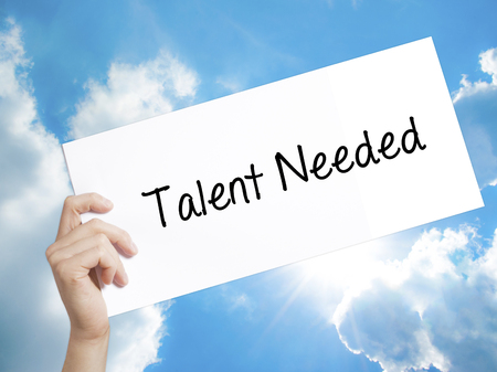 recruit help: Man Hand Holding Paper with text Talent Needed . Sign on white paper. Isolated on Sky background.  technology, internet concept.