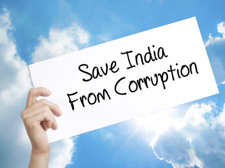 favor: Man Hand Holding Paper with text Save India From Corruption . Sign on white paper. Isolated on Sky background.  Business concept. Stock Photo Stock Photo