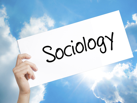 infeasible: Man Hand Holding Paper with text Sociology  . Sign on white paper. Isolated on Sky background.  Business concept. Stock Photo