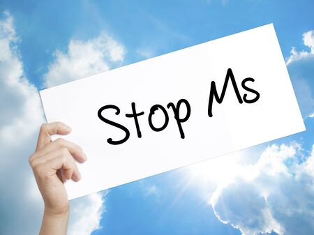 spasms: Man Hand Holding Paper with text Stop Ms . Sign on white paper. Isolated on Sky background.   Business concept. Stock Photo Stock Photo
