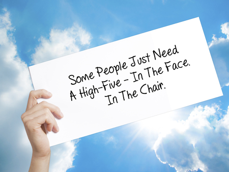 Man Hand Holding Paper with text Some People Just Need A High-Five - In The Face. In The Chair  . Sign on white paper. Isolated on Sky background.   Business concept. Stock Photo Stock Photo