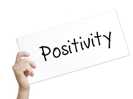 spiritual energy: Paper with text Positivity . Man Hand Holding Sign on white paper. Isolated on white background.  Business concept. Stock Photo