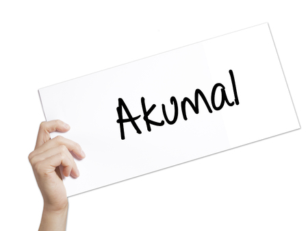 Paper with text Akumal . Man Hand Holding Sign on white paper. Isolated on white background.   Business concept. Stock Photo