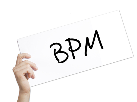 bpm: Paper with text  BPM (Business Process Management) . Man Hand Holding Sign on white paper. Isolated on white background.  Business concept. Stock Photo