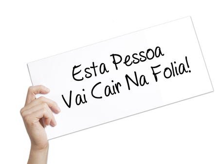 Esta Pessoa Vai Cair Na Folia! (This Person Will be at Carnaval in Portuguese) Sign on white paper. Man Hand Holding Paper with text. Isolated on white background.  Business concept. Stock Photo