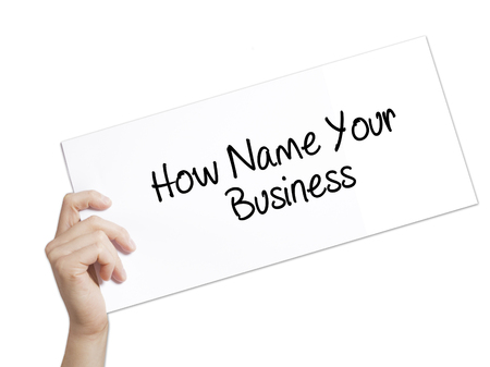 domains: How Name Your Business Sign on white paper. Man Hand Holding Paper with text. Isolated on white background.   Business concept. Stock Photo