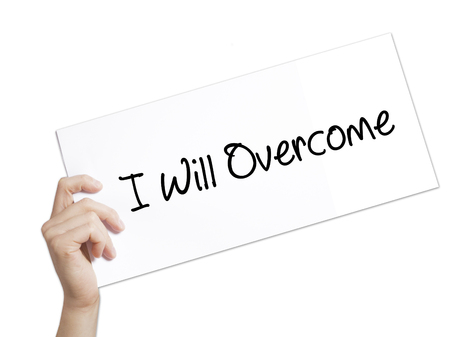 failed politics: I Will Overcome Sign on white paper. Man Hand Holding Paper with text. Isolated on white background.   Business concept. Stock Photo