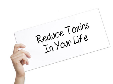reduce: Reduce Toxins In Your Life Sign on white paper. Man Hand Holding Paper with text. Isolated on white background.   Business concept. Stock Photo Stock Photo