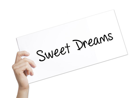 Sweet Dreams Sign on white paper. Man Hand Holding Paper with text. Isolated on white background.  technology, internet concept.