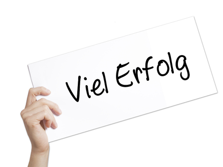 Viel Erfolg (Much Success In German) Sign on white paper. Man Hand Holding Paper with text. Isolated on white background.  Business concept. Stock Photo Stock Photo