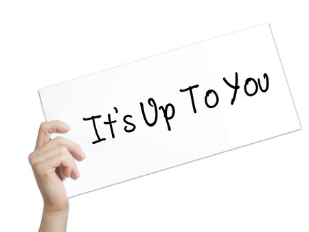 Its Up To You Sign on white paper. Man Hand Holding Paper with text. Isolated on white background.   Business concept. Stock Photo