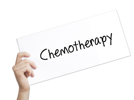 radiotherapy: Paper with text Chemotherapy . Man Hand Holding Sign on white paper. Isolated on white background.   Business concept. Stock Photo