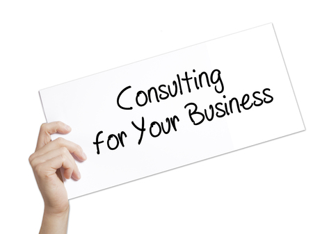 Paper with text Consulting for Your Business . Man Hand Holding Sign on white paper. Isolated on white background.  Business concept. Stock Photo