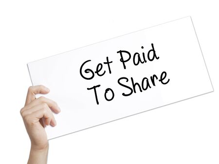 followers: Get Paid To Share Sign on white paper. Man Hand Holding Paper with text. Isolated on white background.  Business concept. Stock Photo