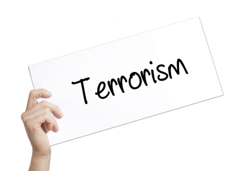 cyber terrorism: Terrorism Sign on white paper. Man Hand Holding Paper with text. Isolated on white background.  technology, internet concept.