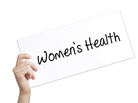 Womens Health Sign on white paper. Man Hand Holding Paper with text. Isolated on white background.   Business concept. Stock Photo