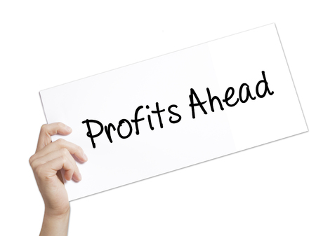 Profits Ahead   Sign on white paper. Man Hand Holding Paper with text. Isolated on white background.   Business concept. Stock Photo