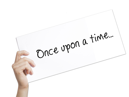 phrase novel: Once upon a time..Sign on white paper. Man Hand Holding Paper with text. Isolated on white background.  Business concept. Stock Photo