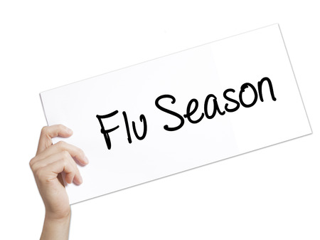 mucus: Flu Season Sign on white paper. Man Hand Holding Paper with text. Isolated on white background.  Business concept. Stock Photo Stock Photo