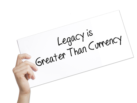 than: Legacy is Greater Than Currency Sign on white paper. Man Hand Holding Paper with text. Isolated on white background.  Business concept. Stock Photo Stock Photo
