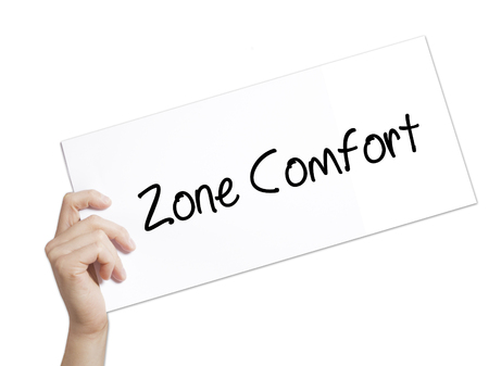 Zone Comfort Sign on white paper. Man Hand Holding Paper with text. Isolated on white background.   internet concept. Stock Photo