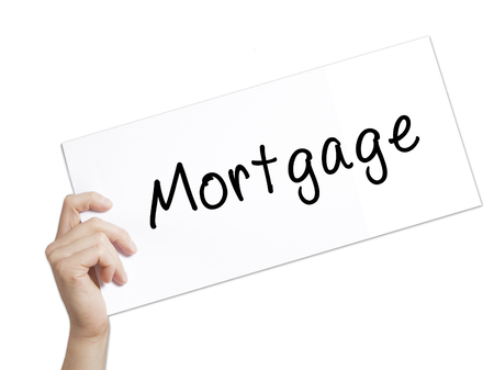 borrowing: Mortgage Sign on white paper. Man Hand Holding Paper with text. Isolated on white background.  Business concept. Stock Photo