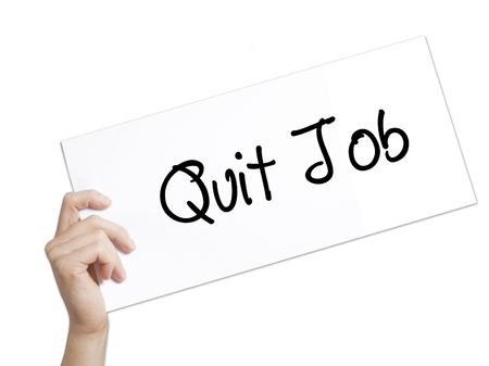 resignation: Quit Job Sign on white paper. Man Hand Holding Paper with text. Isolated on white background.   Business concept. Stock Photo
