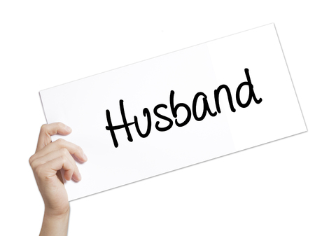 ex wife: Husband Sign on white paper. Man Hand Holding Paper with text. Isolated on white background.  Business concept. Stock Photo