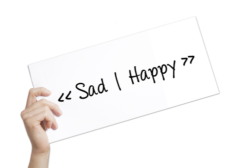 street wise: Sad - Happy Sign on white paper. Man Hand Holding Paper with text. Isolated on white background.  Business concept. Stock Photo Stock Photo
