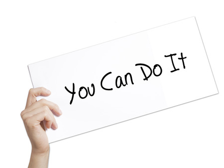 You Can Do It Sign on white paper. Man Hand Holding Paper with text. Isolated on white background.   Business concept. Stock Photo