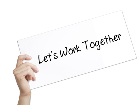 combined effort: Lets Work Together Sign on white paper. Man Hand Holding Paper with text. Isolated on white background.  Business concept. Stock Photo Stock Photo