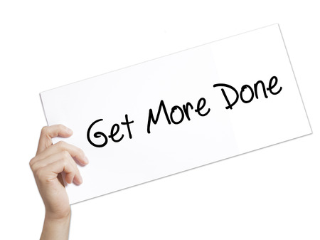 organised: Get More Done Sign on white paper. Man Hand Holding Paper with text. Isolated on white background.  technology, internet concept. Stock Photo