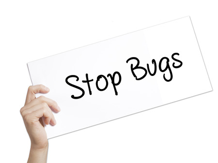 pest control: Stop Bugs Sign on white paper. Man Hand Holding Paper with text. Isolated on white background.  Business concept. Stock Photo Stock Photo