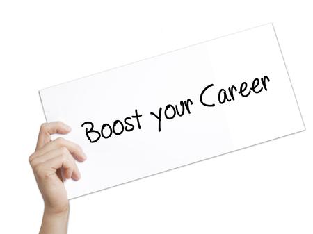 Papier met tekst Boost je carrière. Man Hand Holding Sign op wit papier. Geïsoleerd op witte achtergrond Bedrijfsconcept. Stock foto