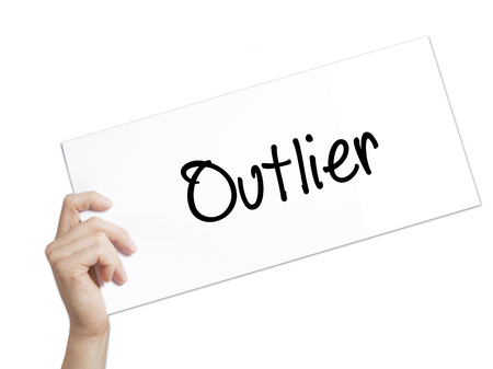Outlier  Sign on white paper. Man Hand Holding Paper with text. Isolated on white background.  Business concept. Stock Photo