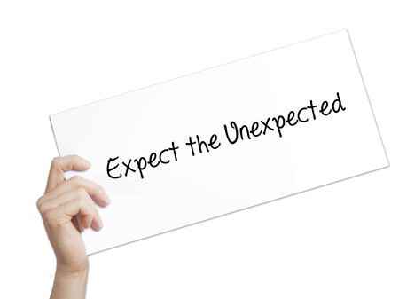unexpected: Expect the Unexpected Sign on white paper. Man Hand Holding Paper with text. Isolated on white background.  technology, internet concept.
