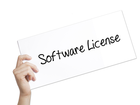 compiler: Software License Sign on white paper. Man Hand Holding Paper with text. Isolated on white background.  technology, internet concept.